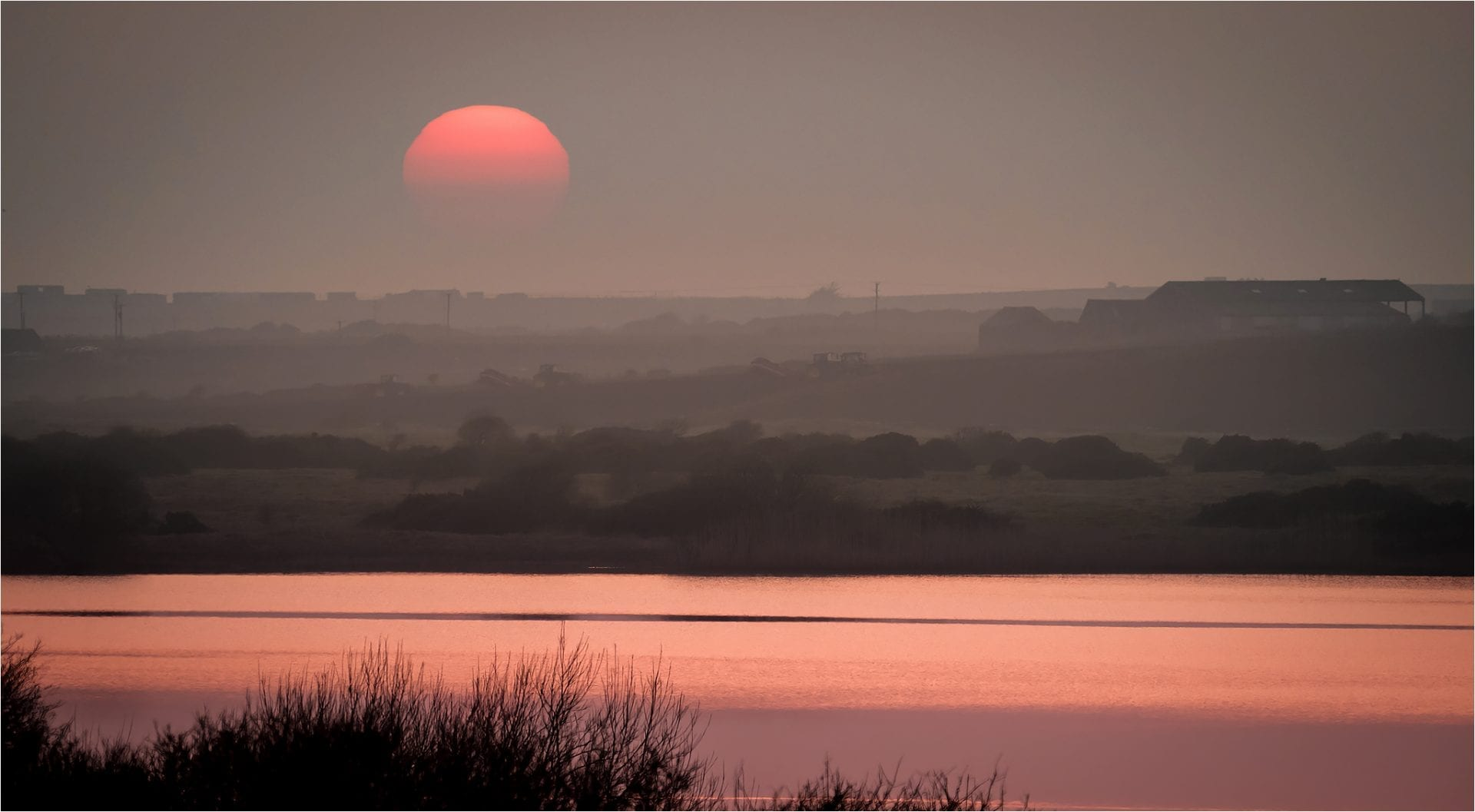 SUNSET OVER LLYN CORON